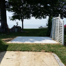 A gravel shed foundation installed by the shore