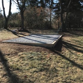 Gravel foundation for a portable storage building