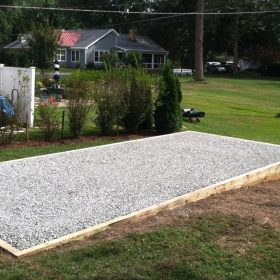 A gravel shed foundation installed for a prefab storage barn