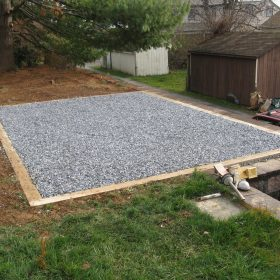 Finished gravel shed base for a storage barn