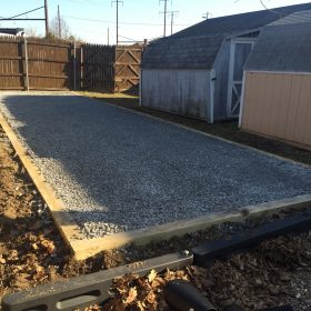 Stone foundation installed for a prefab shed