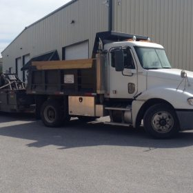 Site Preparations, LLC dump truck, trailer, and skid loader