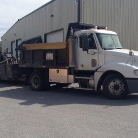 Site Preparations, LLC dump truck, trailer, and skid loader