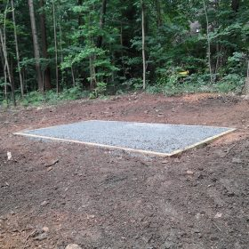A gravel foundation for a prefab shed