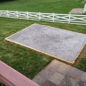 Crushed stone pad for a prefab storage building