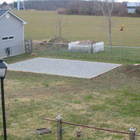 Gravel base for a storage building