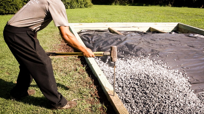 A shed foundation company in PA installing a shed base
