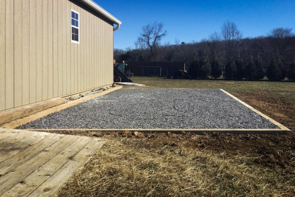 A gravel pad for a shed foundation
