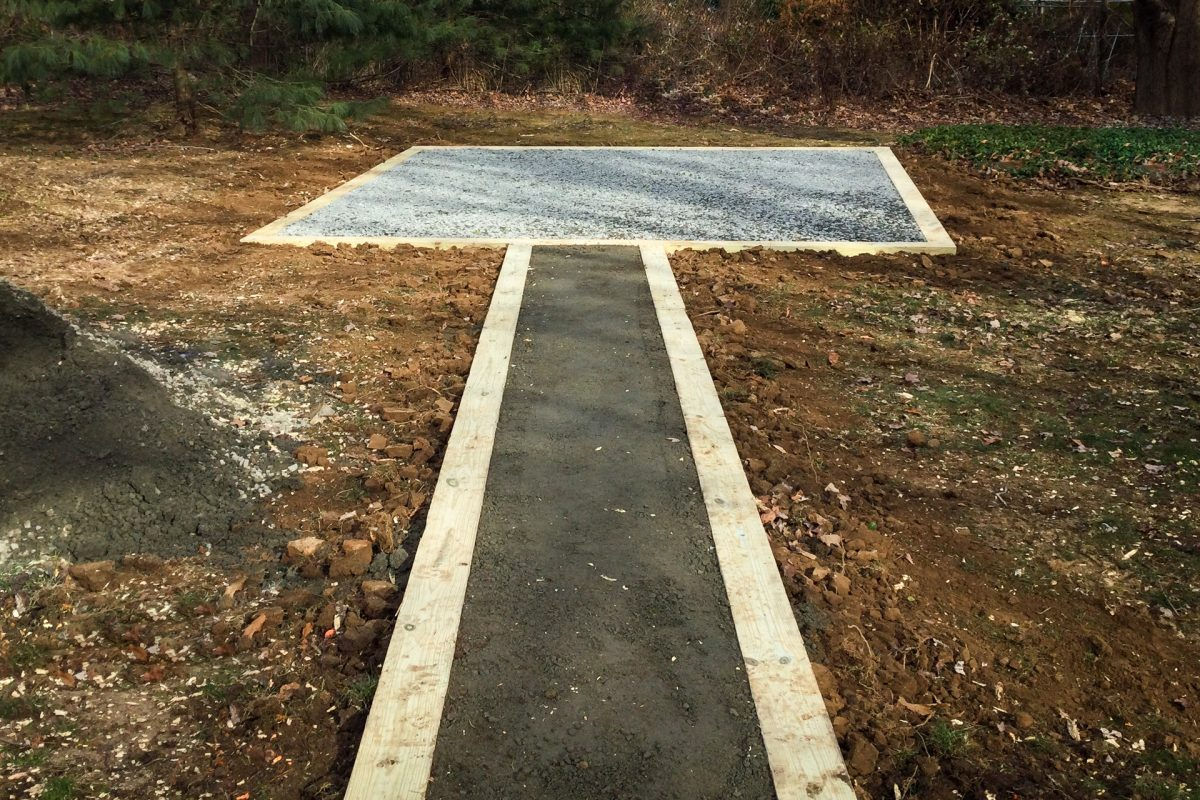 A gravel pad for a garden path and shed