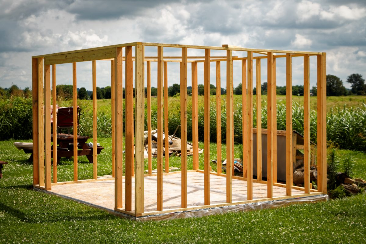The framework and cement foundation of a new shed the same size