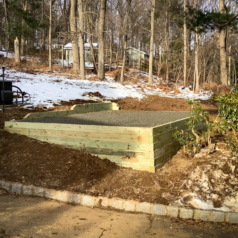 A crushed-stone foundation needed for a shed