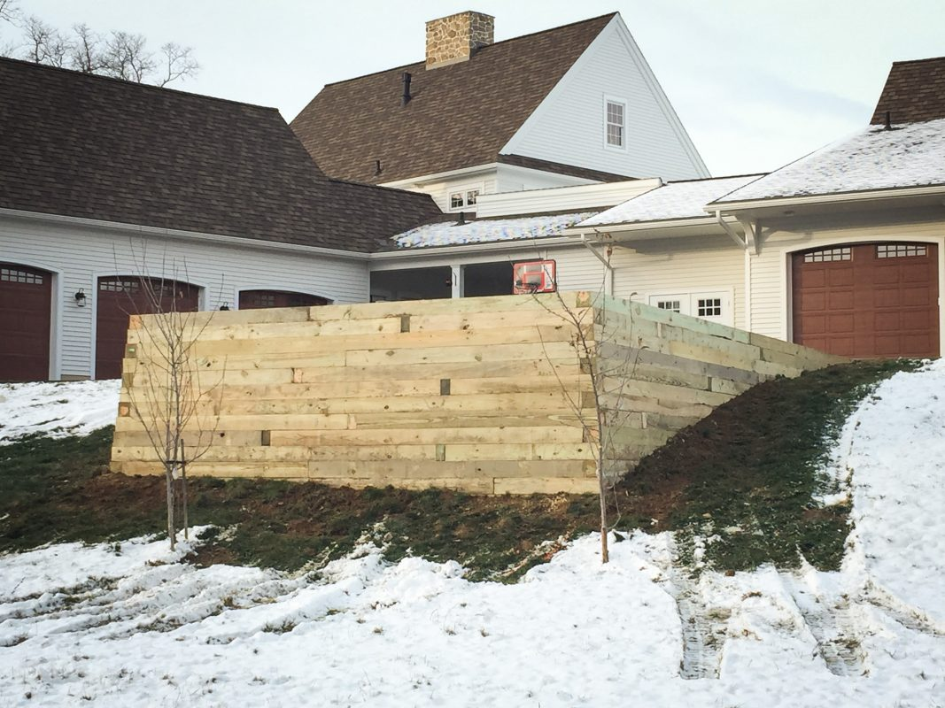 A completed gravel shed pad on a slope