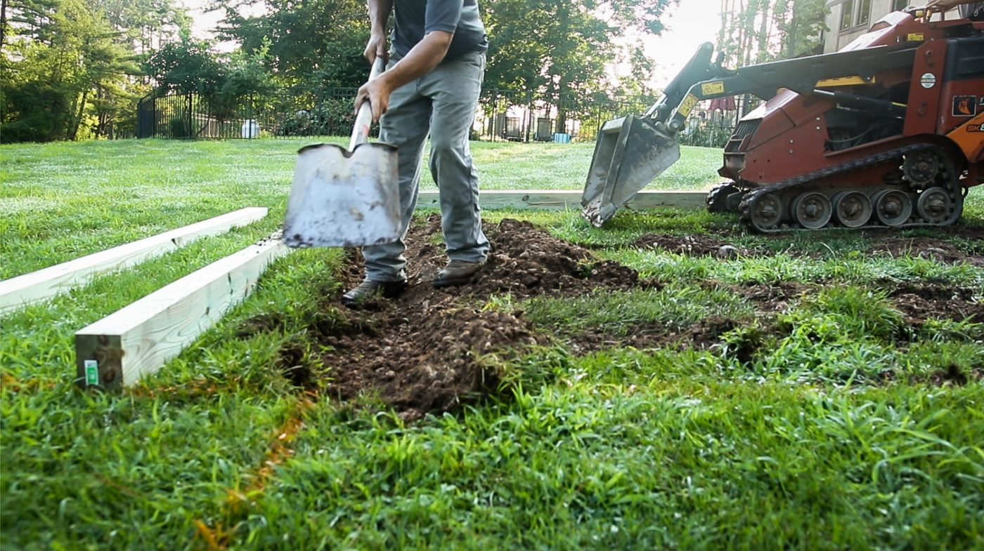 Digging ground to build a gravel shed foundation