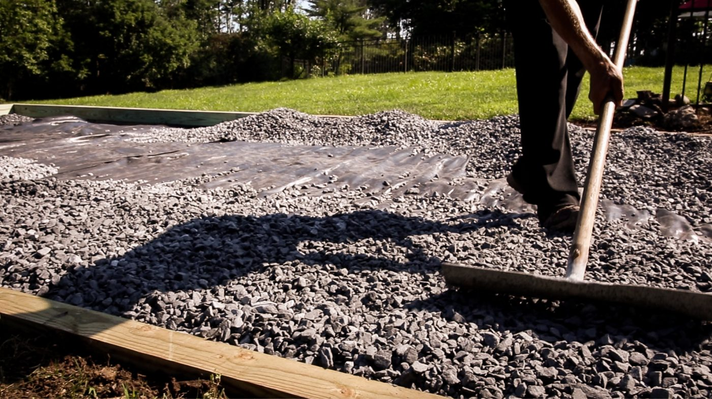 Raking gravel for a shed foundation