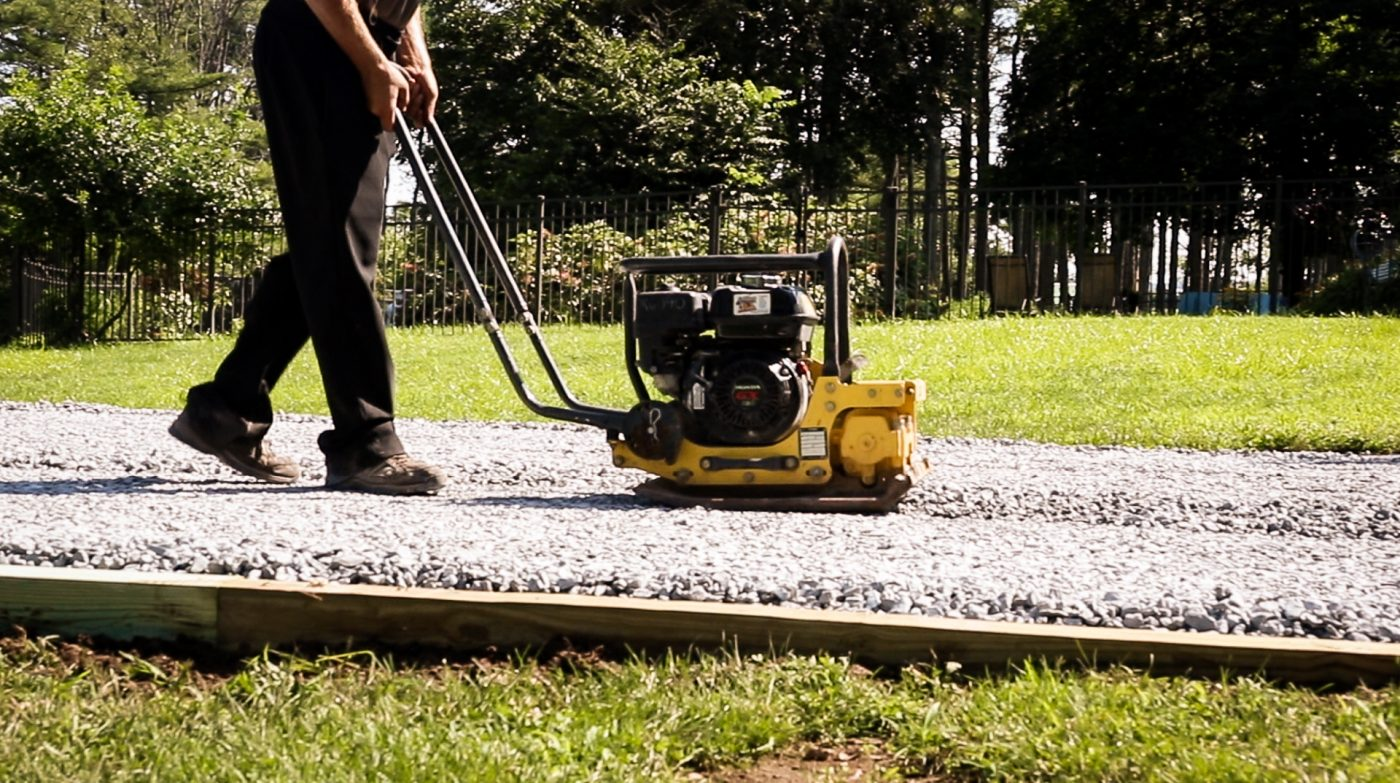 Compacting stone for a gravel shed foundation