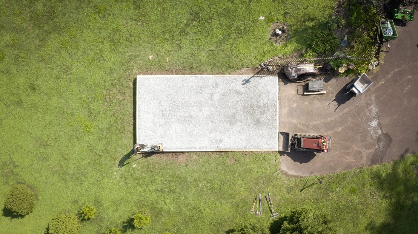 Tamping a gravel shed foundation during installation