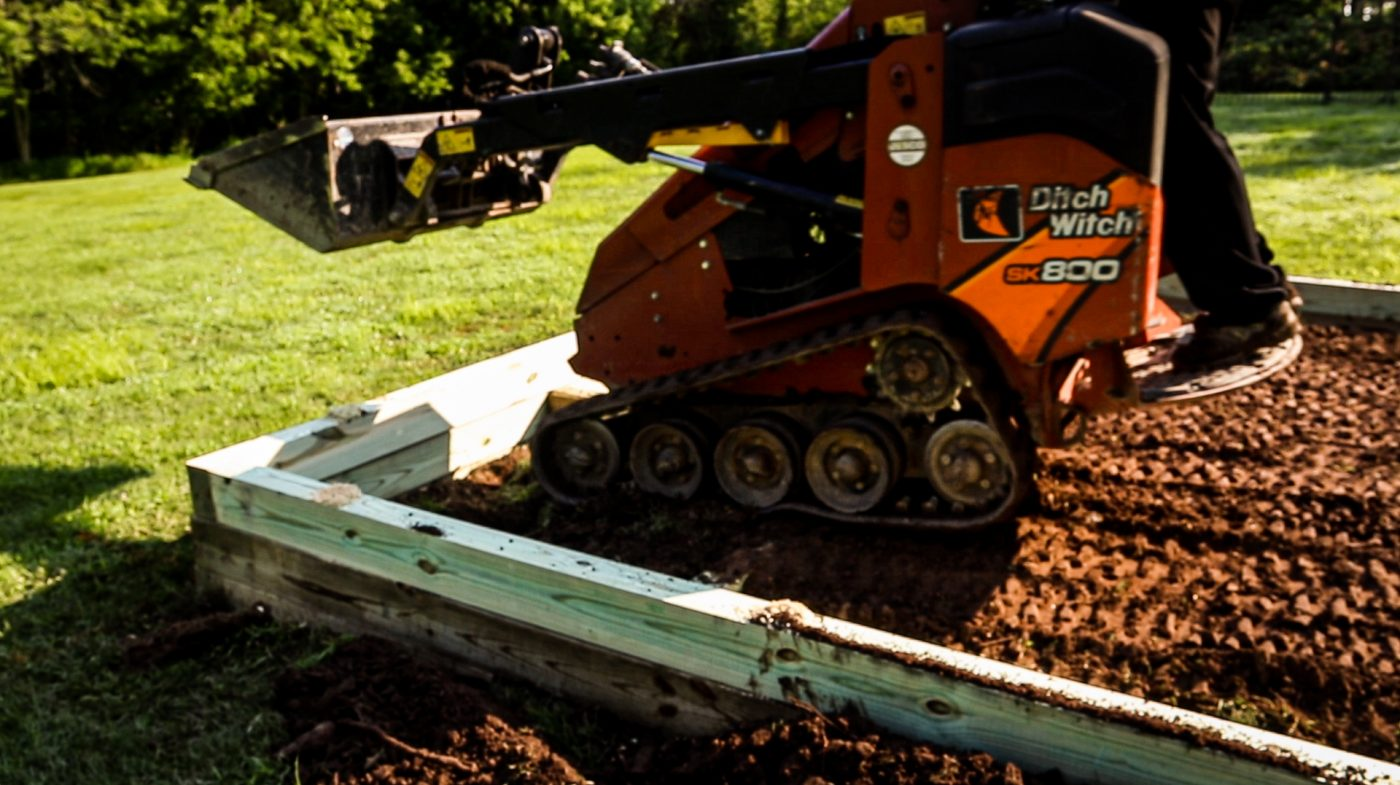How to install a gravel shed foundation with a mini skid steer