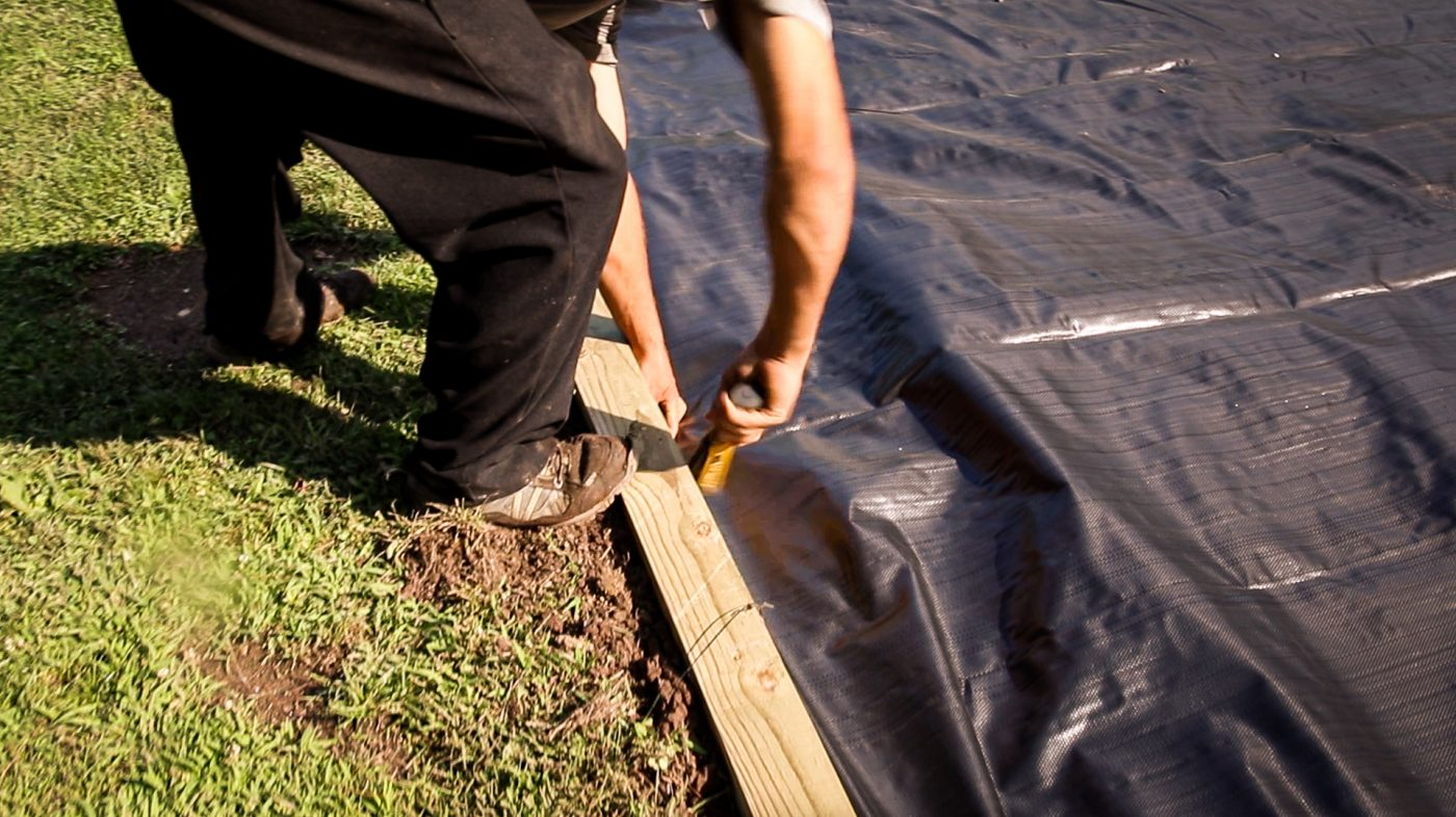 How to add construction fabric to a gravel shed pad