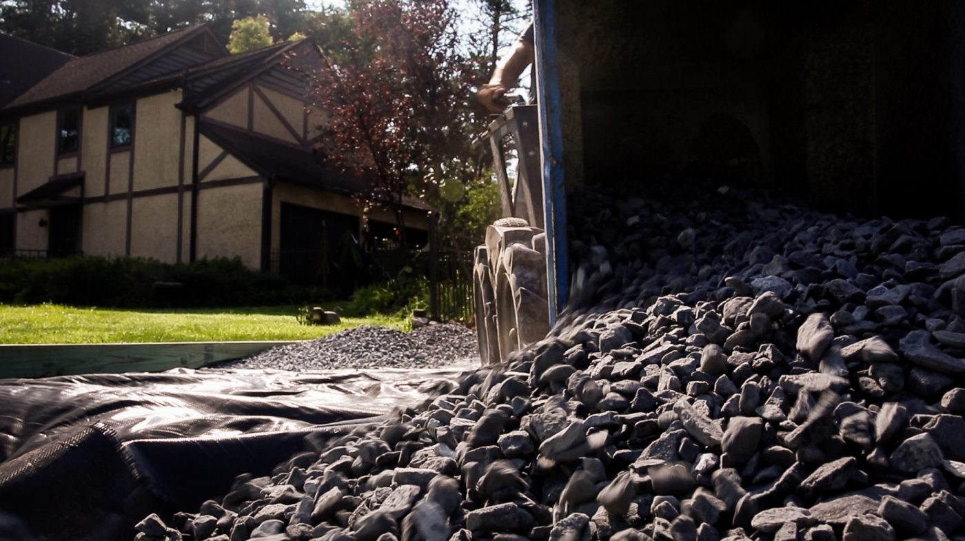 Hauling gravel to install a shed foundation.