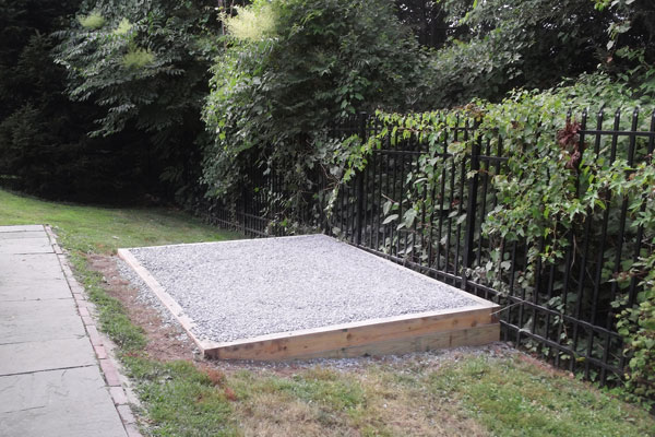 Gravel shed foundation on a hill