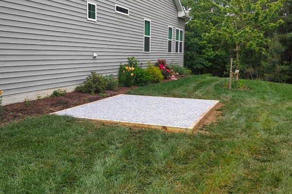 A shed foundation made from crushed stone