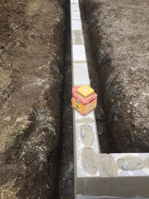 Concrete block footer for a garage foundation