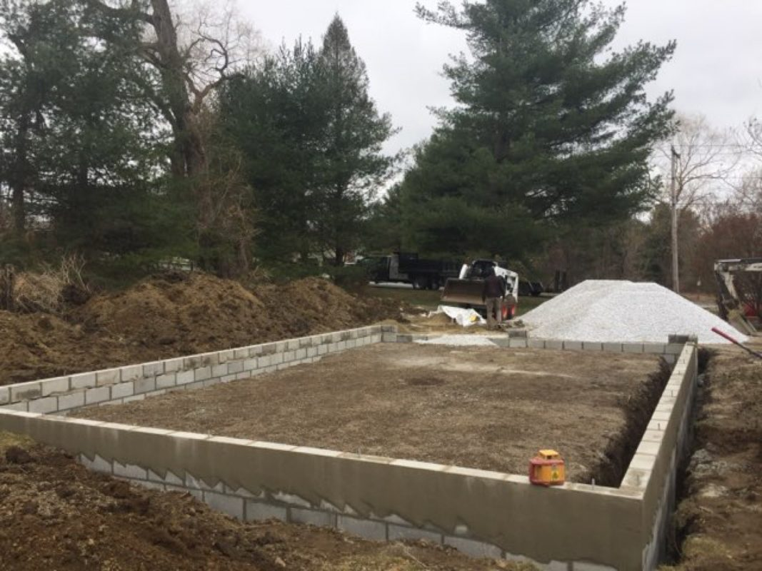 Concrete block footer for a garage