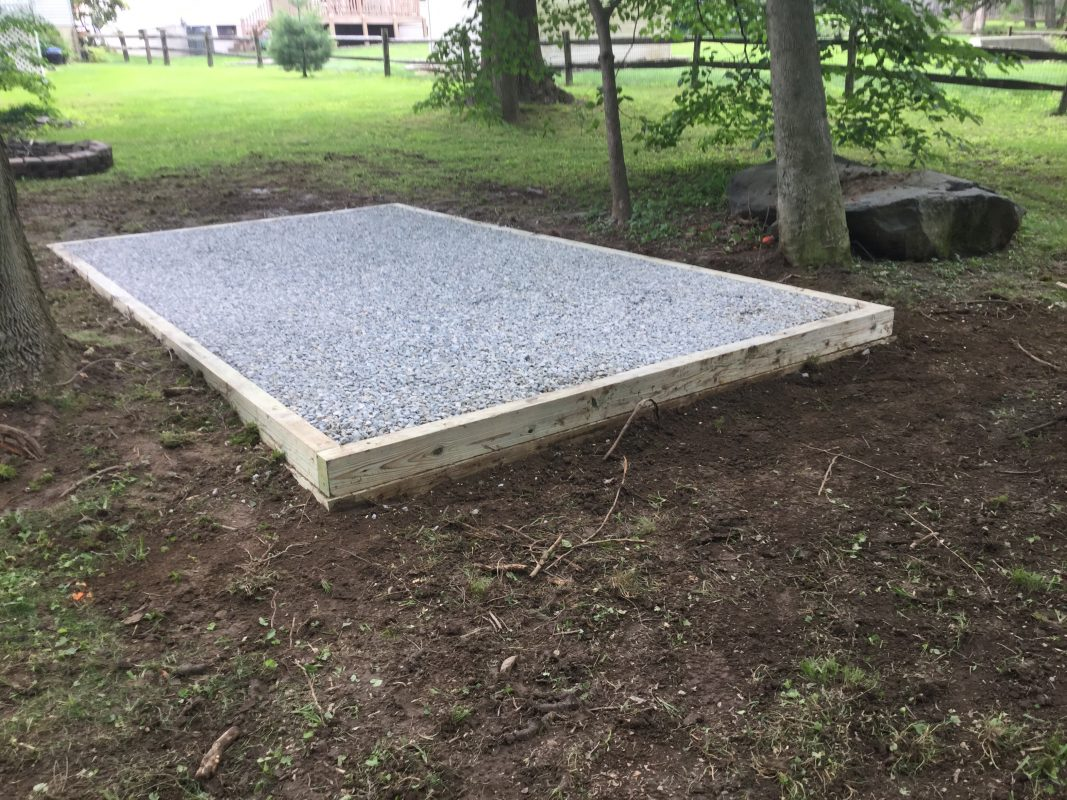 A crushed stone foundation for a shed in Wilmington, DE