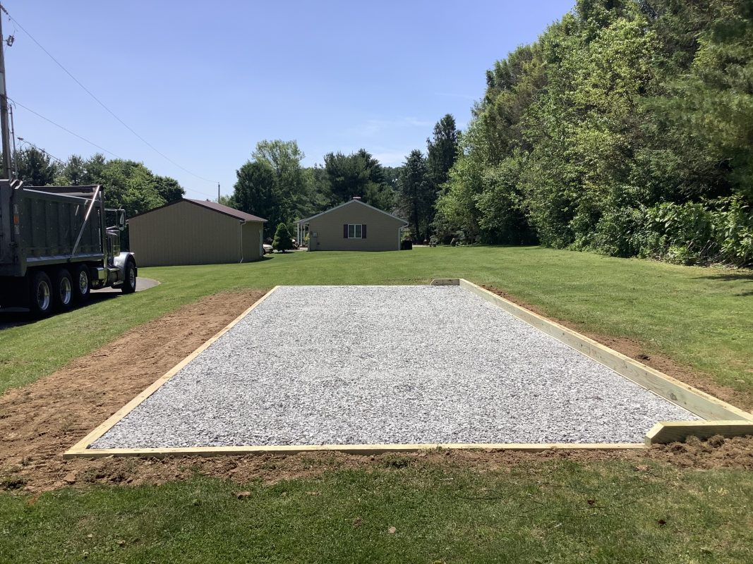 A crushed stone foundation for a shed in Felton, DE