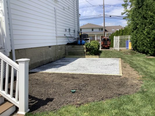 A crushed stone foundation for a shed in Massapequa, NY