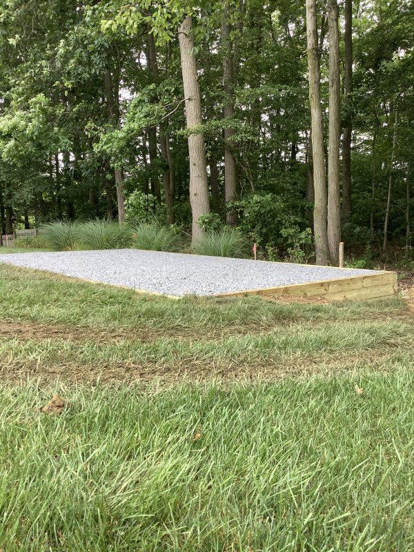 A gravel shed foundation installation in Newark, DE