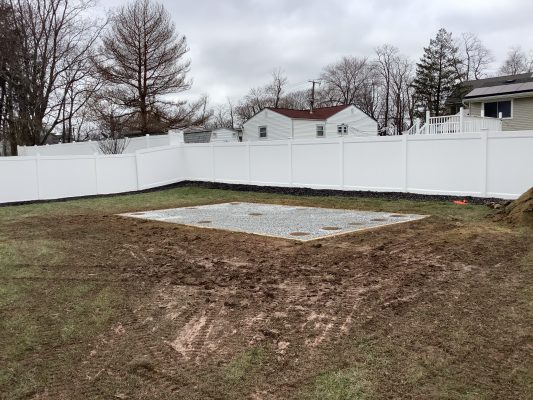 A gravel and concrete piers shed foundation in Hazlet NJ