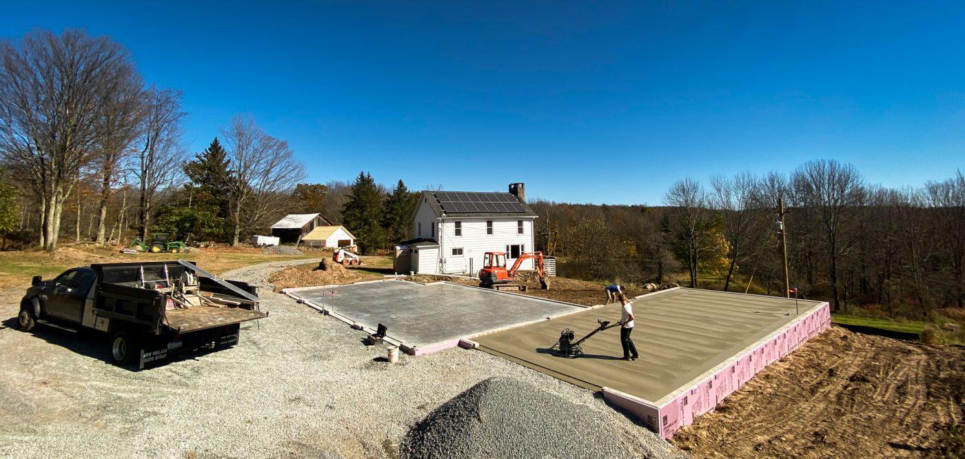 A crew building a concrete garage foundation in PA, CT, VA, MD, DE, NJ, NY, or WV