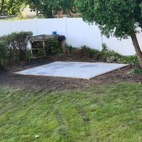 A gravel foundation for a shed