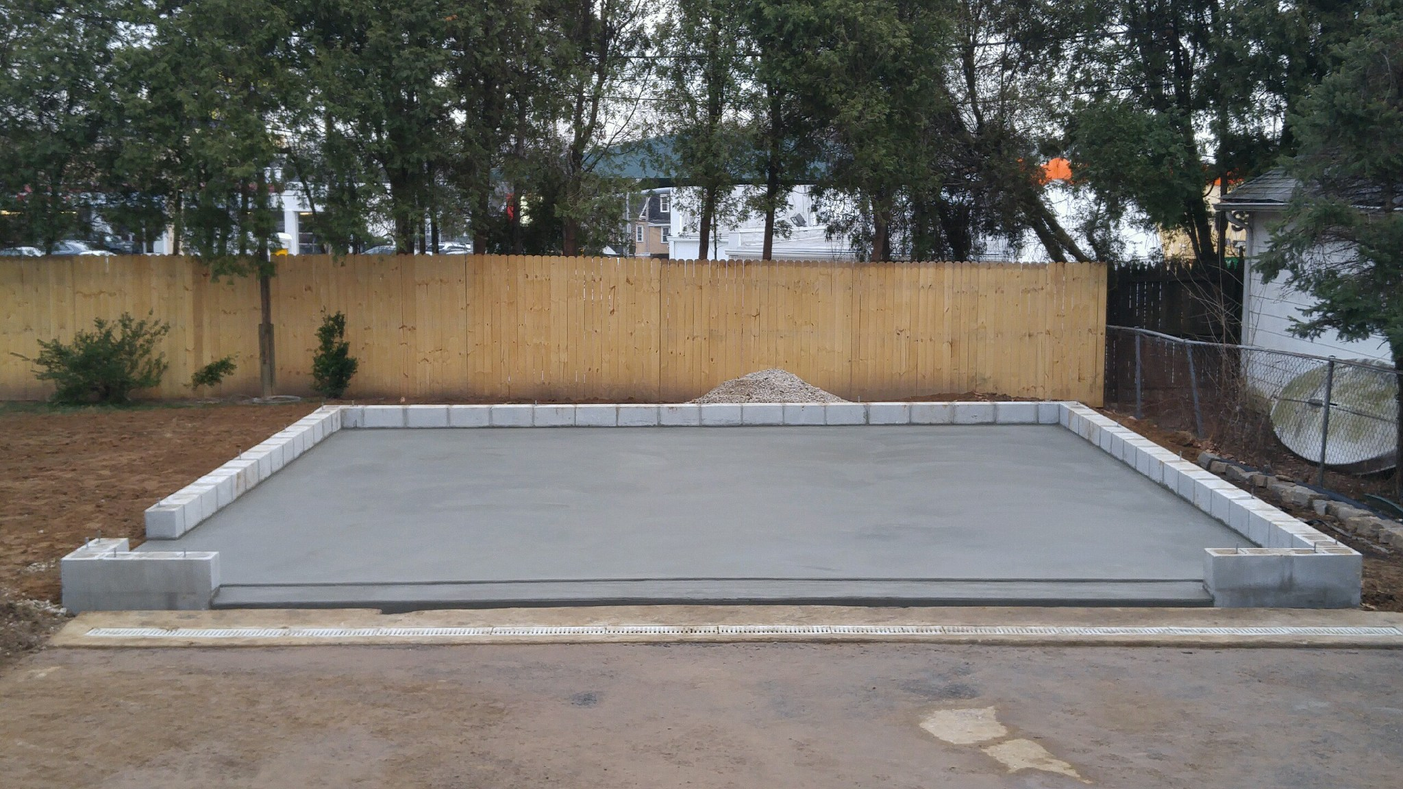 A concrete garage foundation with concrete block footers
