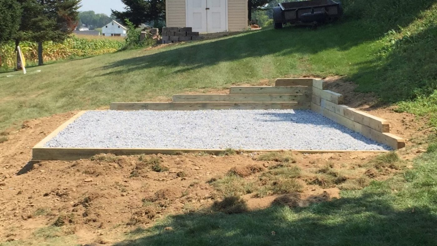 install shed pad retaining wall