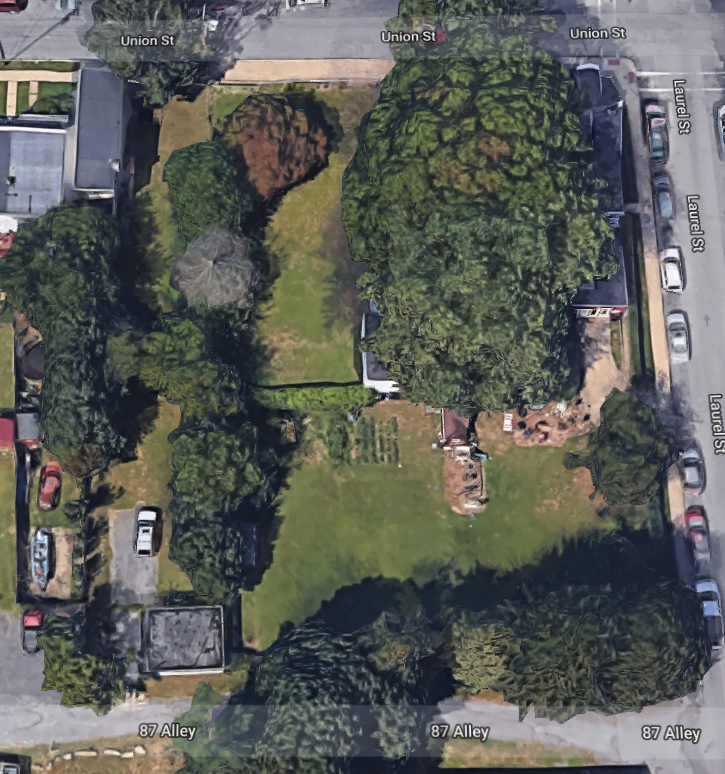 Satellite view of property used to find level ground for a shed