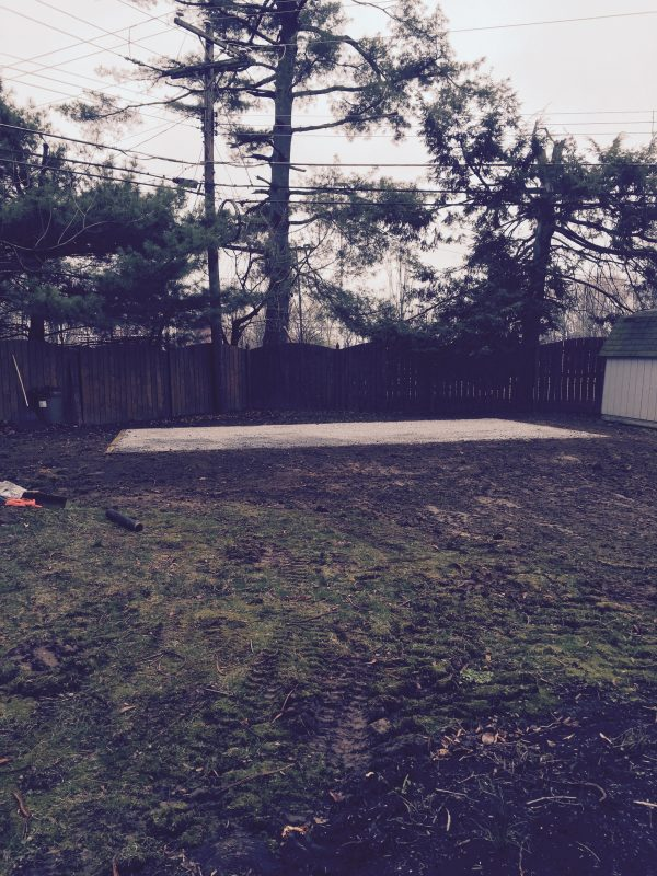 Gravel shed foundation in a backyard