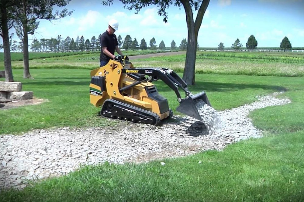 A mini skid steer used to install gravel shed foundations