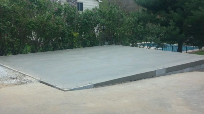 A concrete garage foundation built on a slope