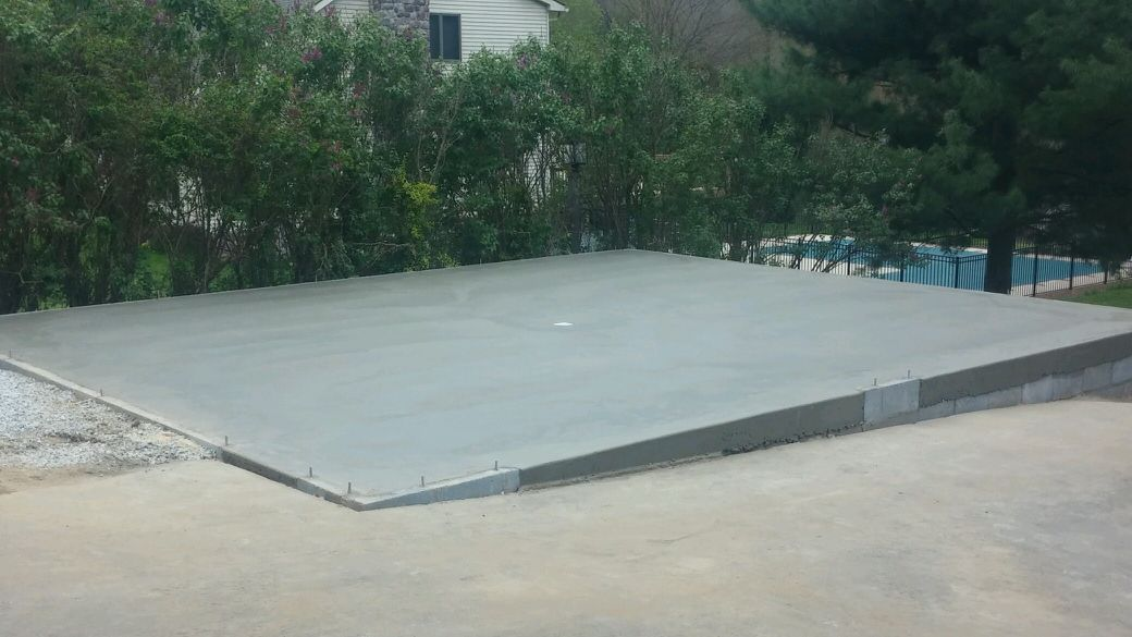 A concrete garage foundation built on a slope