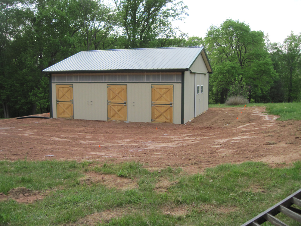 A horse barn with rubber stall mats