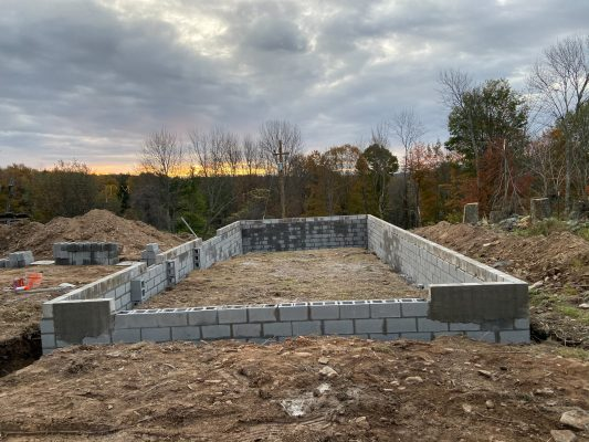 A concrete garage foundation being installed in PA