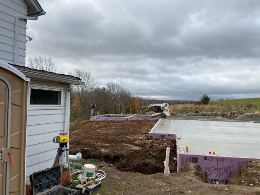 Contractors installing a garage foundation in Greeley, PA