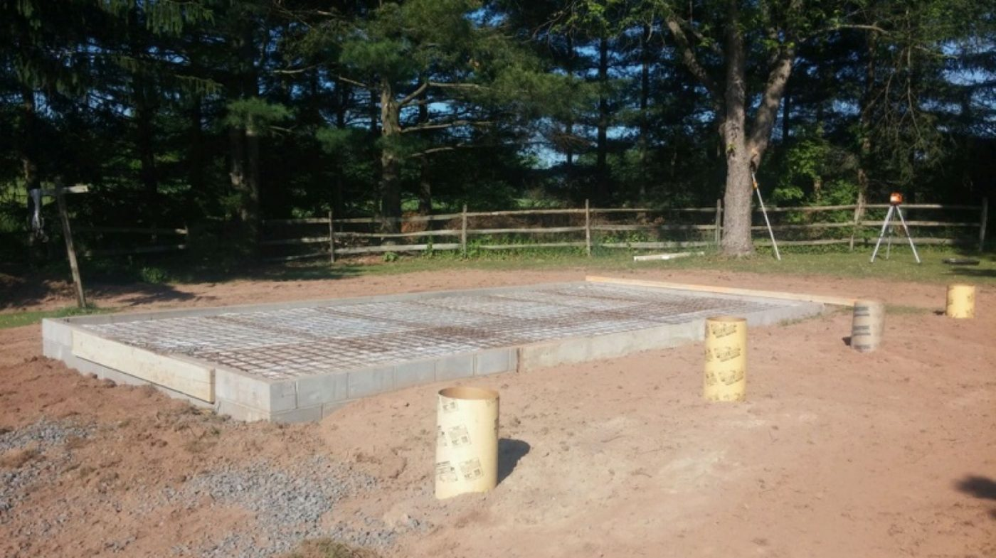 A concrete shed foundation with concrete piers