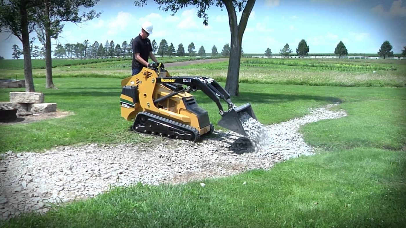 stand up skid loader for shed pad preparations